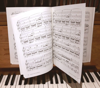 Classical organ score: numerous page turns and unstable binding